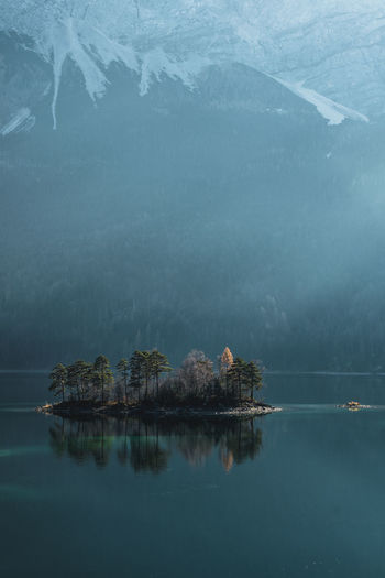 Island on crystal clear lake Island Water Reflection Mirrorlake Lightrays Berchtesgaden Lake crystal clear Landscape Alps Beauty In Nature Scenics - Nature Tranquil Scene Tranquility Tree Waterfront Plant Mountain Nature Non-urban Scene No People Idyllic Day Standing Water Outdoors First Eyeem Photo