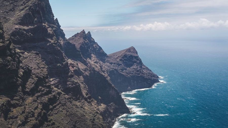 Küste von Gran Canaria Sea Sky Water Beauty In Nature Scenics - Nature Nature Tranquility Tranquil Scene Cloud - Sky Mountain Day No People Rock Formation Travel Outdoors Rock Land Travel Destinations Tourism Horizon Over Water