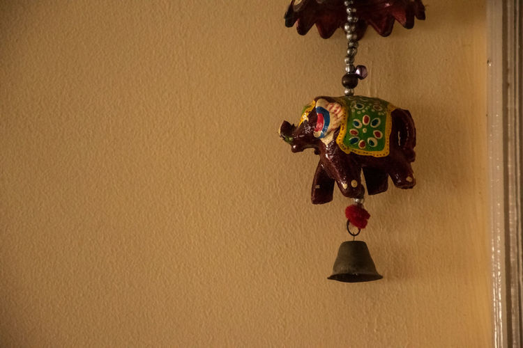 Close-up of decoration hanging on wall