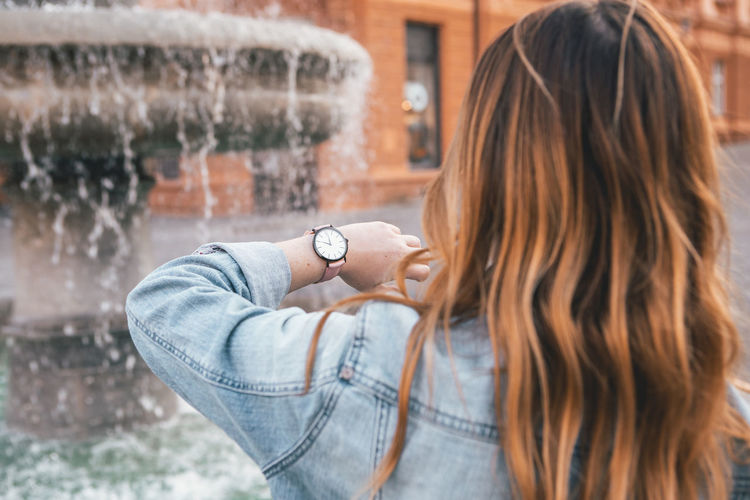Close up portrait of Young woman city lifestyle with Watch on her wrist One Person Hair Brown Hair Focus On Foreground Real People Lifestyles Headshot Hairstyle Portrait Long Hair Leisure Activity Day Women Young Adult Adult Architecture Casual Clothing Standing Outdoors Brick Rain Fashion Blogger Watch Urban Urbanphotography City Ljubljana Slovenia Portrait Of A Woman Woman Young Women Casual Look