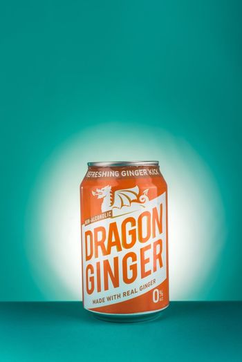 🐉 Brigford Text Indoors  Western Script Colored Background Communication Blue Container Table Close-up Single Object Capital Letter Copy Space Wall - Building Feature Blue Background Green Background No People Studio Shot Still Life Food Red