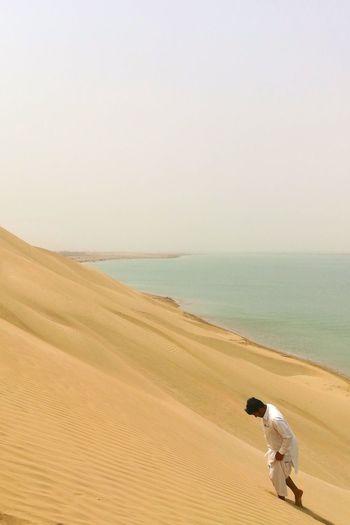 EyeEm Best Shots EyeEmNewHere EyeEm Selects Sand Dune Sea Clear Sky Desert Full Length Beach Sand Men Water Arid Climate