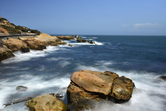 Beach Beauty In Nature Clear Sky Cliff Day Horizon Over Water Motion Nature No People Outdoors Rock Rock - Object Rock Formation Scenics Sea Sky Tranquil Scene Tranquility Water Wave 台灣 清涼感 萬里 野柳地質公園 龜吼漁港