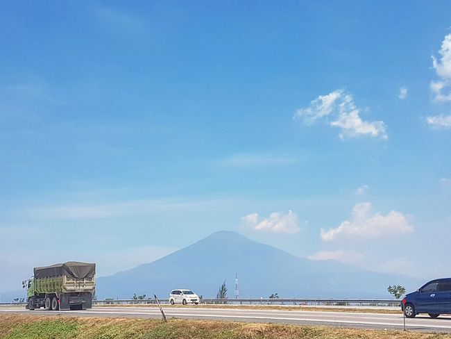 On my way ⛰🚗🚛 Day Mountain Ciremai Sky Nature Landscape Outdoors Lost In The Landscape Conected Whit Travel Indonesia_photography Landscape_photography Skyscape Highway View Road Roadtrip Cars Onmyway Cipali Cirebon  Westjavaindonesia