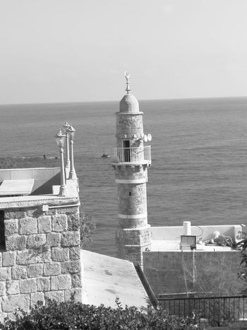Sea Horizon Over Water Lighthouse Water Building Exterior Outdoors Travel Destinations Architecture Sky No People Tranquility Built_Structure Nature Politics And Government Huawei P10 Plus Huaweip10plus Isra_yafo Huawei Photo Shoot Huaweiphotography Huawei Shots EyeEm Selects Sunlight Let's Go. Together. Market Bestsellers 2017 Black & White Friday