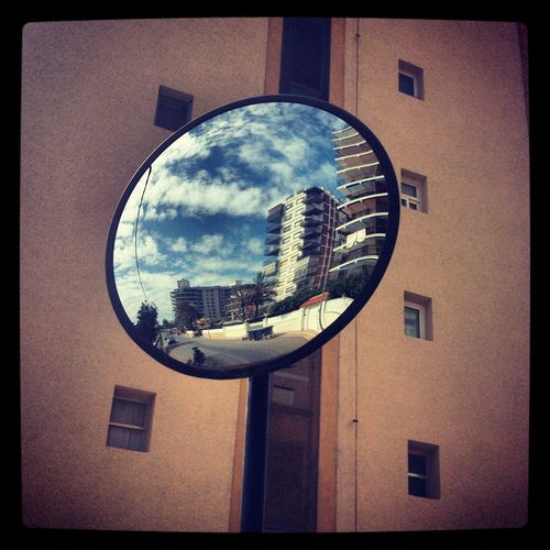 Reflection of buildings on glass window