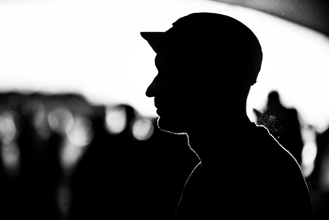 silhouette, real people, focus on foreground, men, one person, lifestyles, music, leisure activity, outdoors, close-up, day, musician, young adult, people