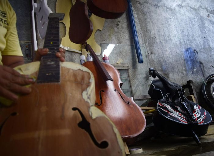 Cropped image of person with old cellos