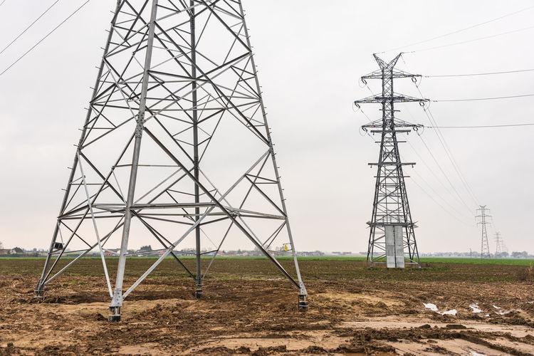 Electricity distribution system. high voltage overhead power line, power pylon, steel lattice tower