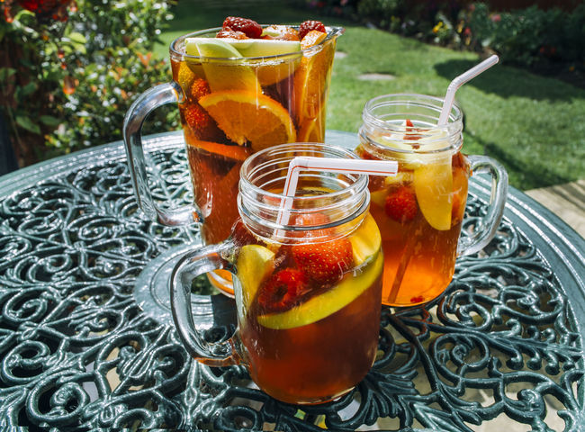 fruit drink jug with glasses in garden in the summer BBQ Pimps Alcoholic Drink Close-up Day Drink Drinking Glass Food Food And Drink Freshness Fruit Fruit Drink Garden Healthy Eating Ice Tea Jar Mint Tea No People Outdoors Refreshment Summer Table Tea - Hot Drink