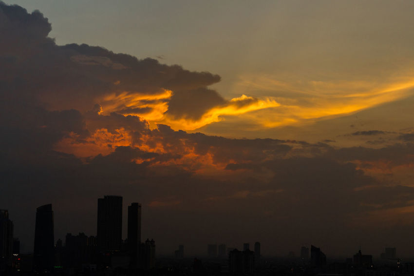 Glowing Fiery Afternoon Sky Afternoon City Cityscape Darkness Glorious Sunset Skyline Afternoon Sky Beauty In Nature City Cityscape Cloud - Sky Darkness And Light Fiery Sky Fiery Sunset Nature No People Outdoors Scenery Silhouette Sky Skyline Sunset Urban Skyline