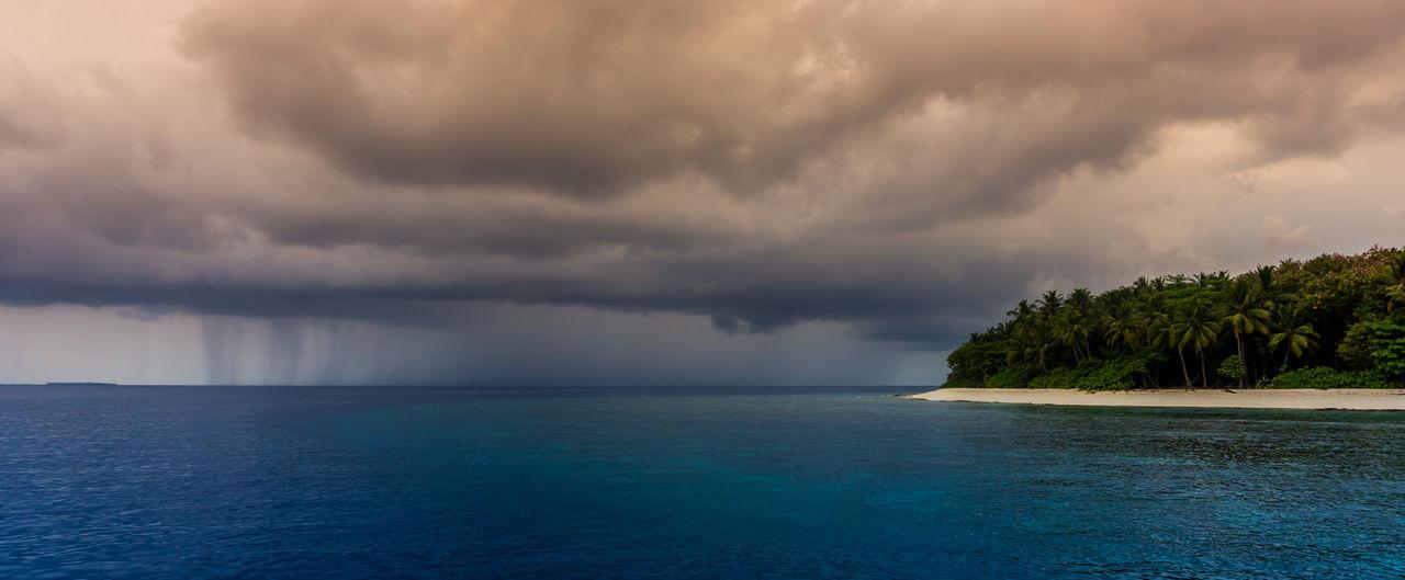 Maldives Rain Rainy Days Storm Beauty In Nature Cloud - Sky Day Dramatic Sky Horizon Over Water Idyllic Nature No People Outdoors Rainy Day Scenics Sea Sky Storm Cloud Tranquil Scene Tranquility Tree Tropical Tropical Storm Water Waterfront