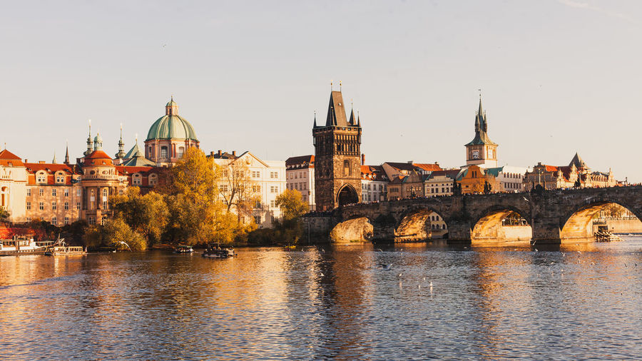 Charles bridge over river against buildings in city