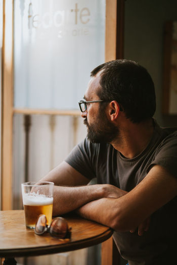 Midsection of man sitting at table