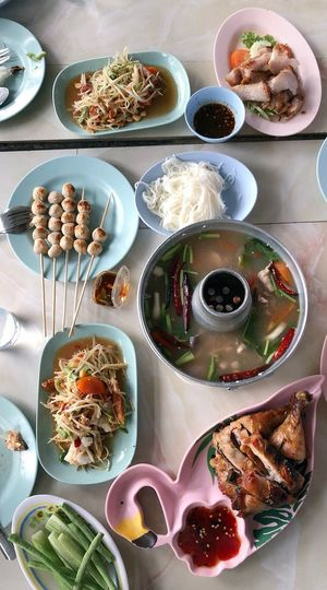 Top view of traditional northern Thai food flat lay, papaya salad or som tam ,grilled chicken,vegetable,grilled pork ,spicy soup on the table in the restaurant Somtam  Somtum Food Food And Drink Ready-to-eat Table High Angle View Meal