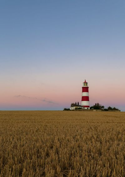 Good morning! Lighthouse EyeEm Selects Nature EyeEm Gallery EyeEm Nature Lover Holidays Seaside Sunrise Dawn Red And White Tall - High Light On Guidance Lighthouse Agriculture Cereal Plant Field Tower
