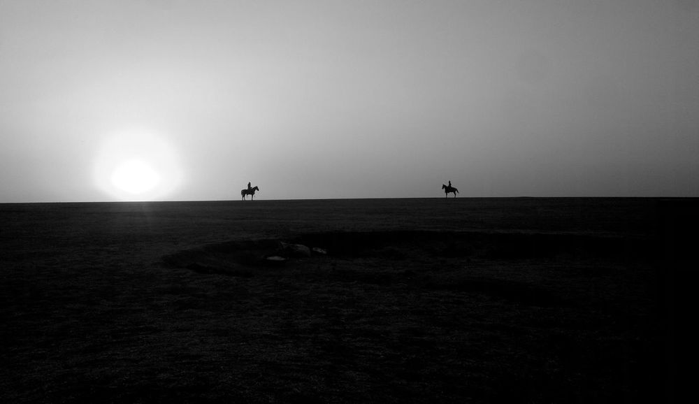 Duel of Villians Duel Duel Of Villains Horses Arid Climate Army Generals Beauty In Nature Black And White Blackandwhite Clear Sky Day Field Horizon Over Land Landscape Men Nature Outdoors People Real People Scenics Silhouette Sky Sun Sunset Summer Exploratorium Visual Creativity
