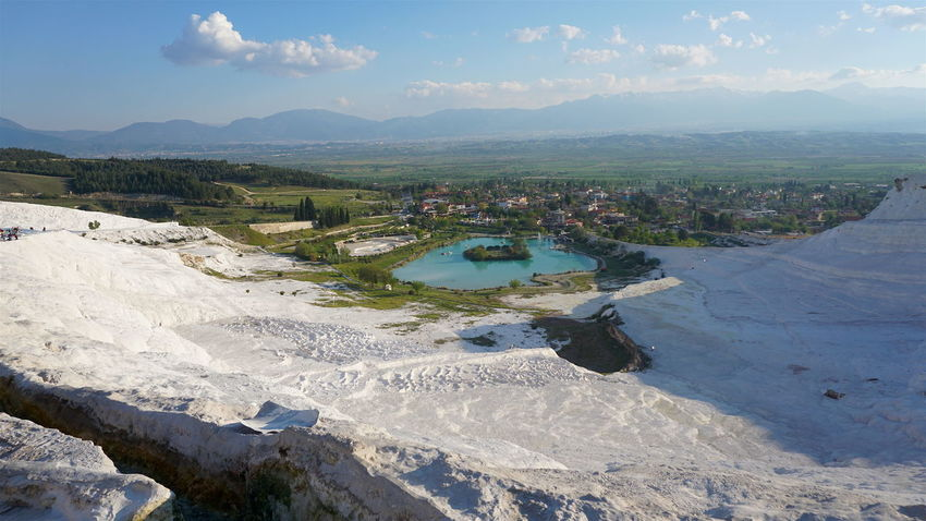 White Calcium travertines and pools as a heritage geological langscape of Pamukkale Pamukkale Travertenleri Pamukkale/Turkey Beauty In Nature Cloud - Sky Day Landscape Mountain Nature No People Outdoors Pamukkale Scenics Sky Tranquil Scene Tranquility Travel Destinations Tree Water