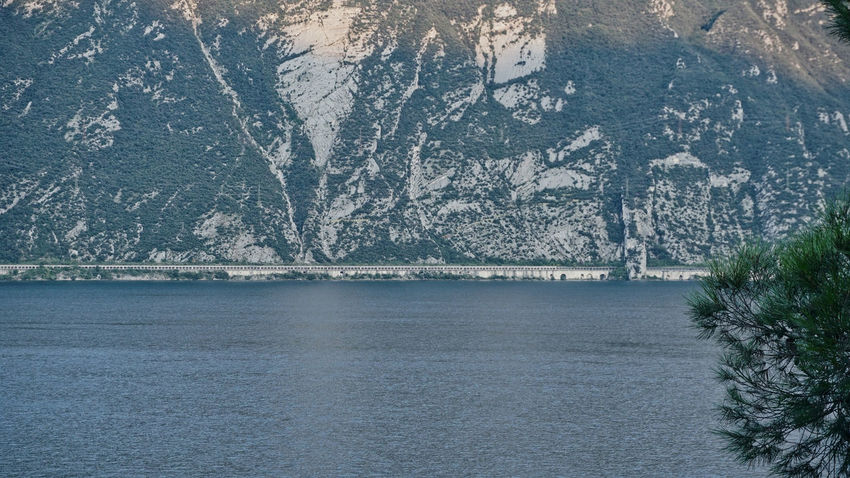 Lago Di Garda Water Tree Plant Mountain No People Nature Beauty In Nature Day Scenics - Nature Waterfront Winter Tranquil Scene Tranquility Architecture Outdoors Sea Snow View Into Land Old Road