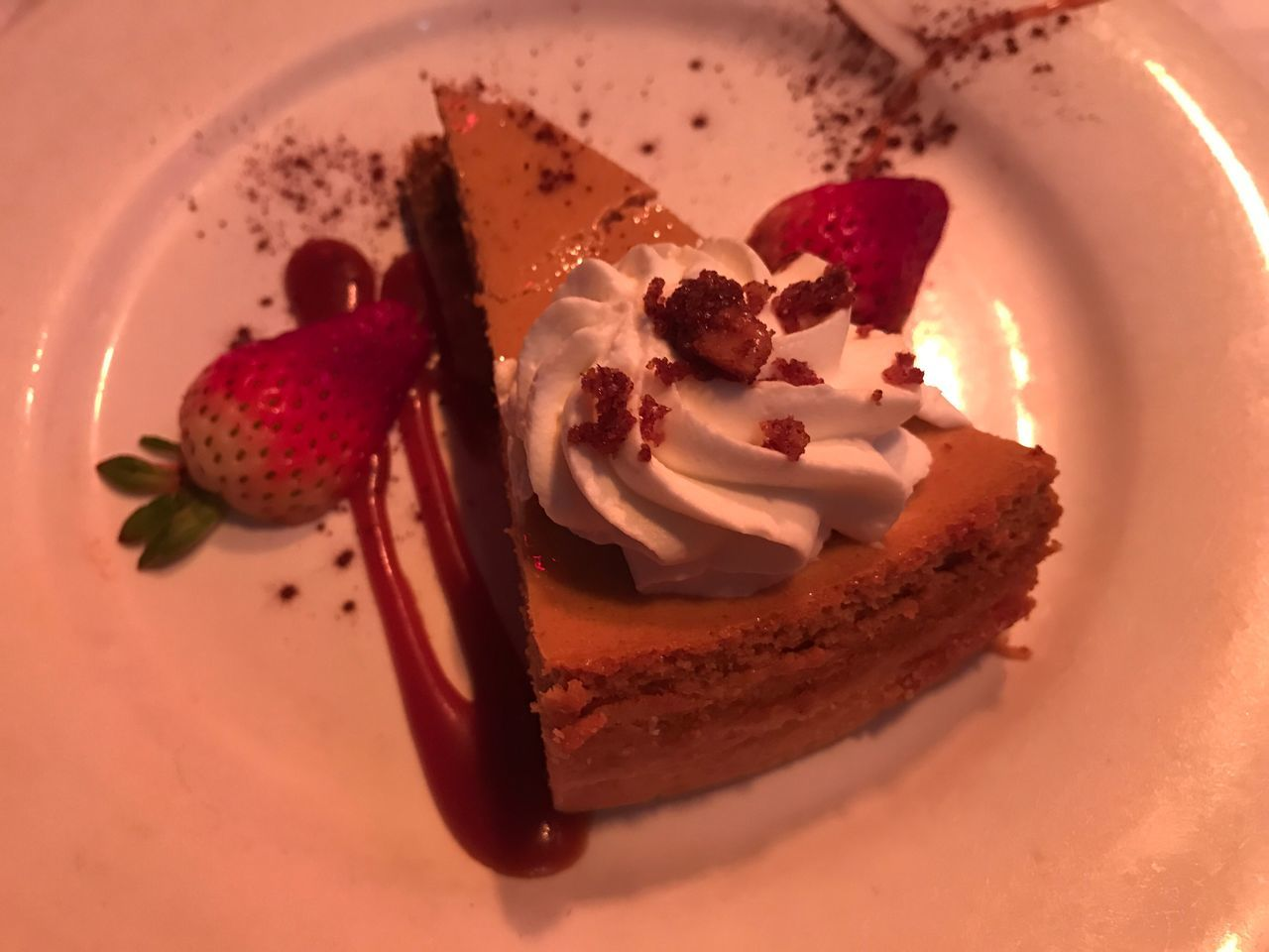 High Angle View Of Pumpkin Cheesecake In Plate