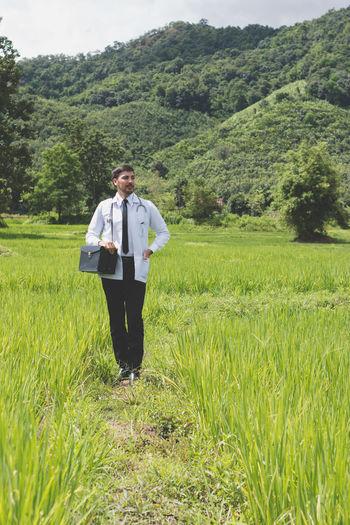 Full Length Of Doctor Walking On Field