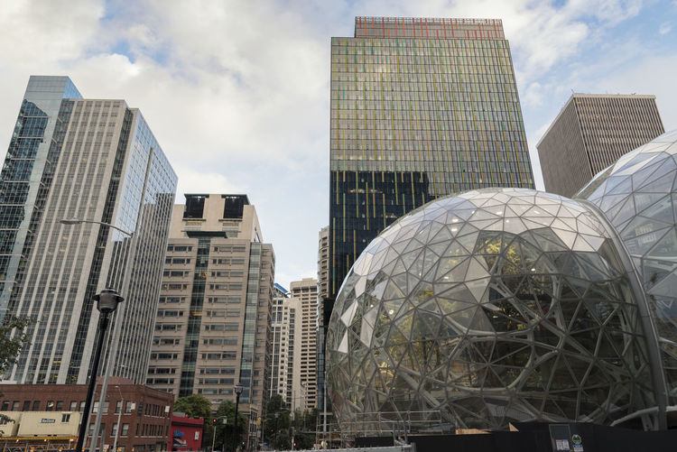 The Amazon world headquarters campus buildings and terrarium spheres Architecture Business Campus Construction Downtown Economy Growth Leader Seattle Shopping Washington Amazon Design Employees Expansion Glass Greenhouse Grounds Headquarters Hiring Landscape Online  Overcast Terrarium World