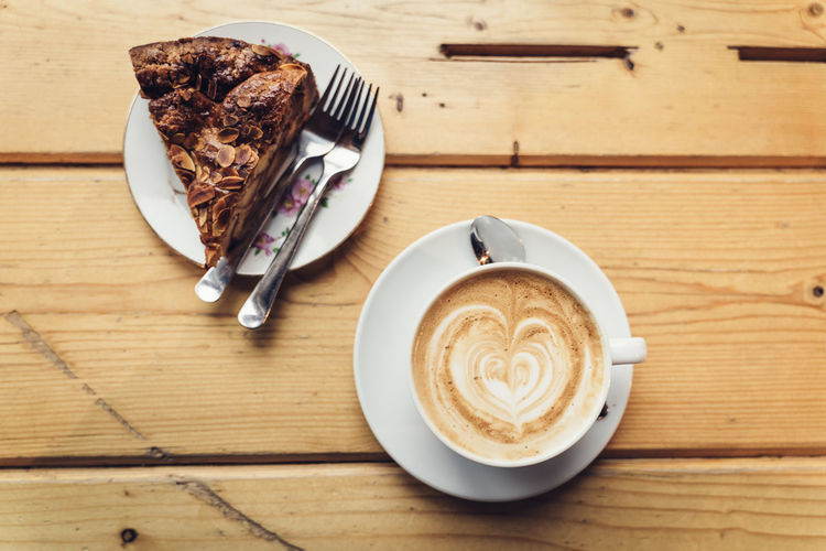 Amsterdam delights: Traditional Apple Cake and Cappuccino on wooden table Food And Drink Coffee Coffee - Drink Still Life Table Coffee Cup Eating Utensil Cup Mug Indoors  Cappuccino Wood - Material No People Amsterdam Netherlands Apple Cake Tart Apple Tart