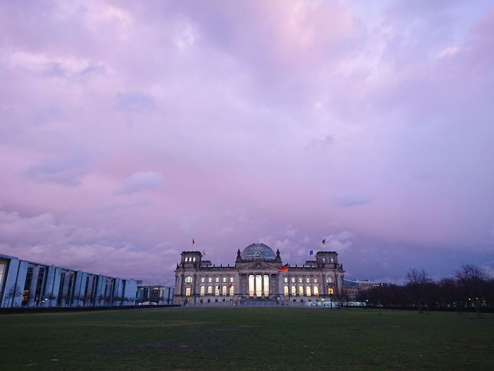 Reichstag building, seat of german parliament deutscher bundestag, during a cloudy day at sunset