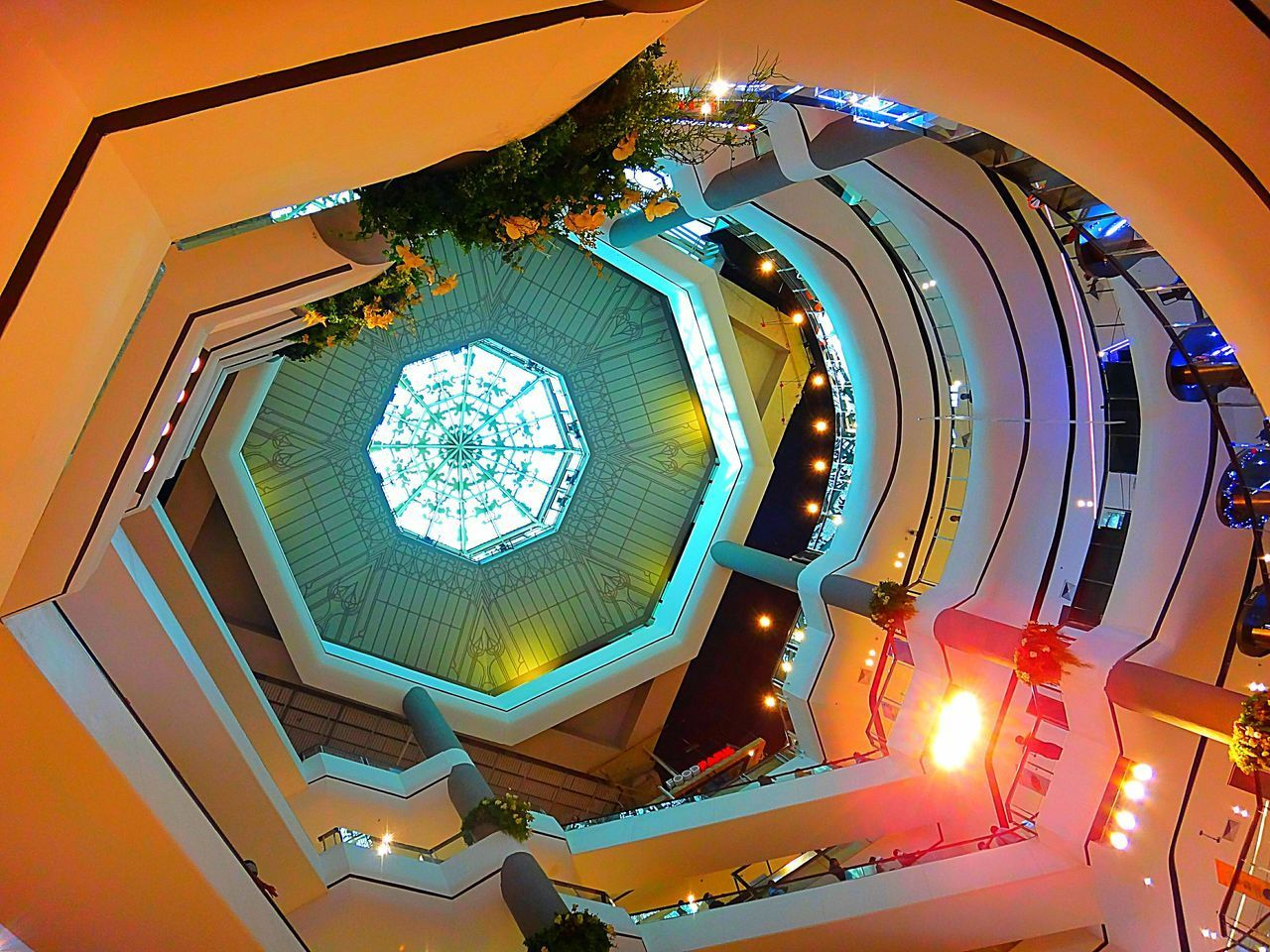 low angle view, architecture, illuminated, indoors, built structure, no people, ceiling, lighting equipment, building, pattern, directly below, shape, glass - material, design, night, hanging, geometric shape, modern, architectural feature, light, ornate, light fixture, luxury, cupola, architecture and art