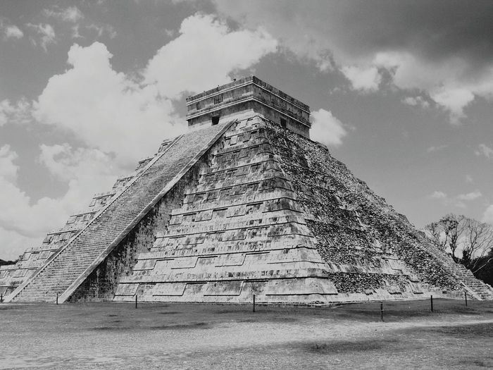 View Of Chichen Itza Against Cloudy Sky