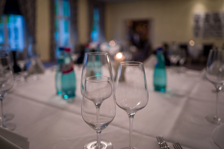 Close-up of wineglasses on table in restaurant