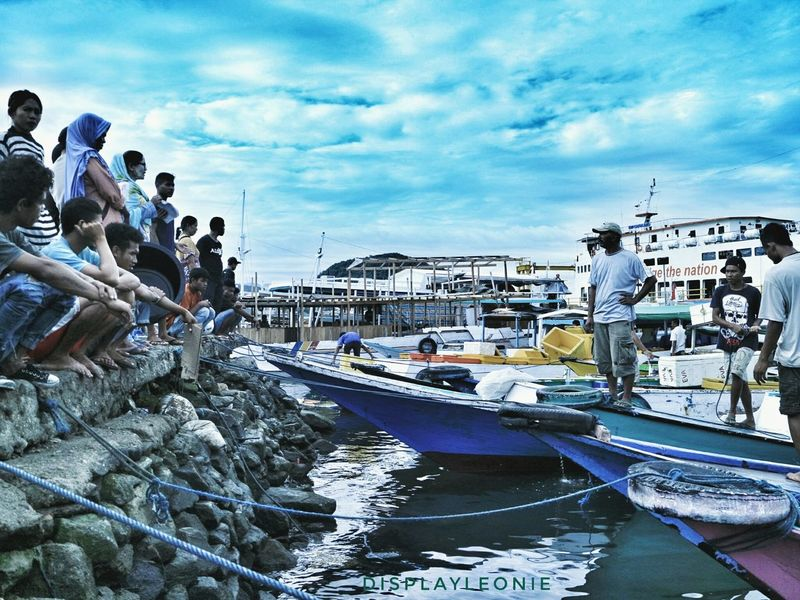 They watched, ..they waited for the fish landing Labuan Bajo Flores NTT, Fishing Jetty Fishing Port