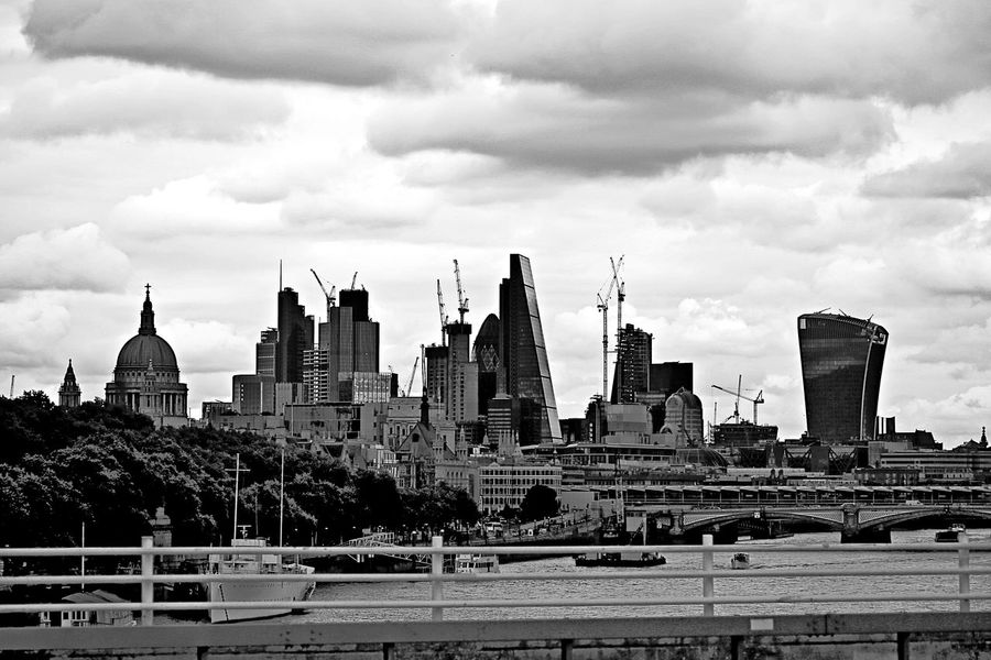 Thames city skylineLost In London Growth Sillouettes Architecture Building Exterior Urban Skyline Cityscape City Skyscraper Cloud - Sky Modern Sky Architectural Design River Thames BankTaking Photos Street Photography Urban Geometry Close-up 3XSPUnity Architecture Black And White Photography Edited My Way Balck And White Collection High Buildings Postcode Postcards