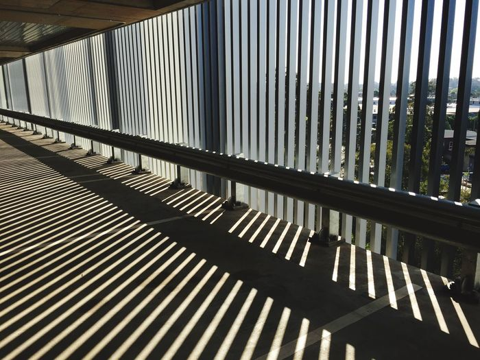 Low angle view of railing against building