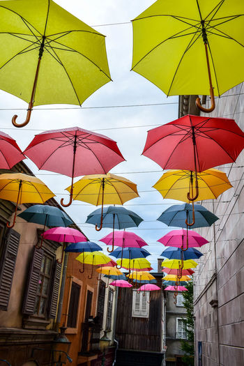 Colorful umbrellas hanging on clothesline