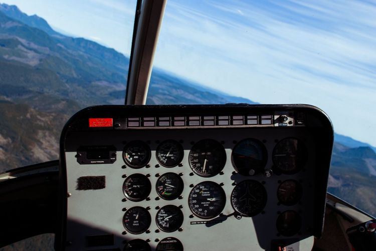 Cockpit Of Helicopter Flying Over Mountains