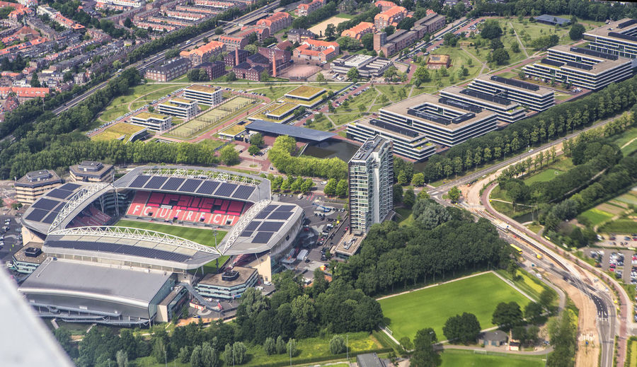 Aerial Shot Football Soccer Field Soccer Dutch Football Stadium FC Utrecht Aerial View Architecture Building Exterior Built Structure Cityscape Day Football Utrecht Football Club Football Stadium Football Stadium Linz Football Stadiums Green Color High Angle View Landscape Mode Of Transportation Outdoors Residential District Road Soccer Club Soccer Stadium Stadium FC Utrecht Stadium From The Sky Stadium Photo Taken From Airplane Utrecht