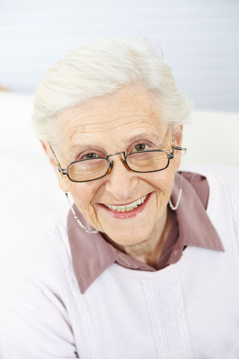 Portrait of a smiling senior woman on land