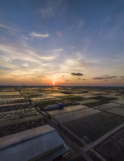Sky Sunset Cloud - Sky Scenics - Nature Beauty In Nature Nature No People Environment Landscape Airplane Transportation Outdoors Mode Of Transportation Air Vehicle Tranquil Scene Tranquility Orange Color Agriculture Field Rural Scene