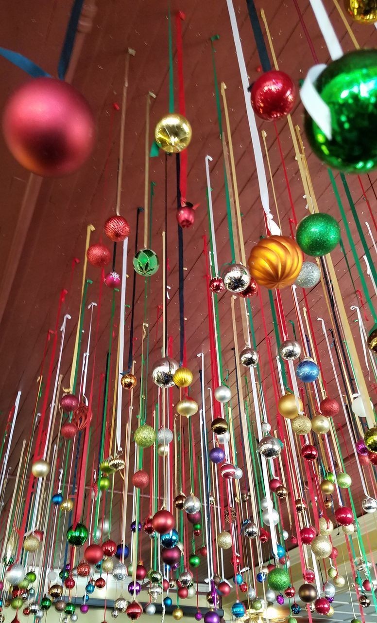 low angle view, no people, decoration, indoors, multi colored, large group of objects, illuminated, lighting equipment, abundance, celebration, arts culture and entertainment, built structure, red, music, architecture, in a row, hanging, candle, close-up