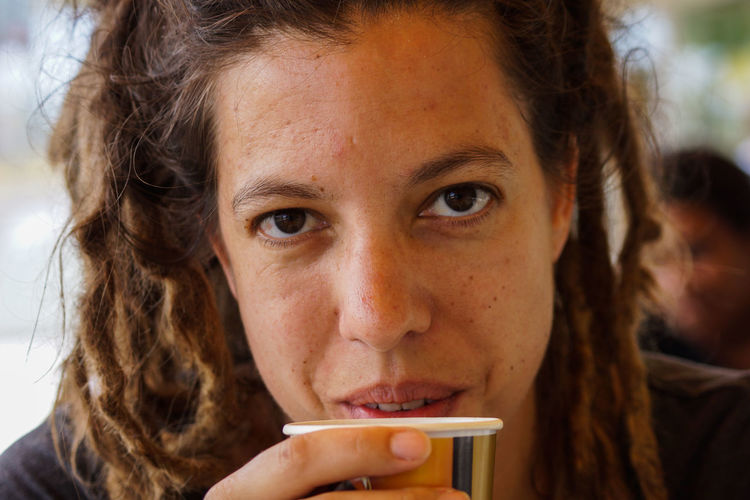 Close-Up Portrait Of Mid Adult Woman Drinking Coffee