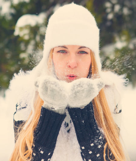 Portrait of young woman in snow