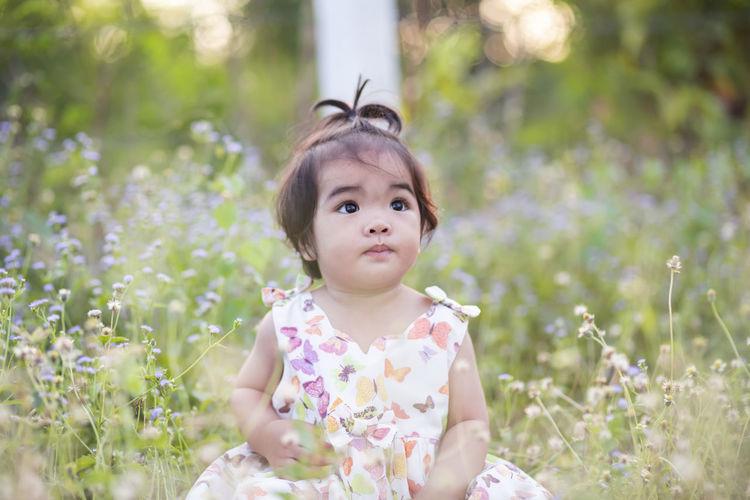Portrait of cute girl in flower field