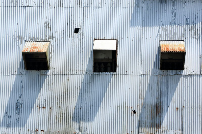 tiny windows on tin ore dredging ship Industrial Architecture Building Exterior Built Structure Corrugated Iron Day Factory Building No People Outdoors Windows Windows_aroundtheworld