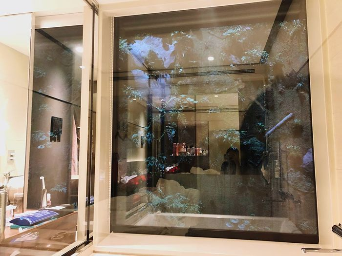 Reflection of glass window on display at store