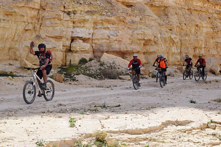 Celebrate Your Ride Ride Riding Riding Bike Bike The Color Of School Bicycle Rider Desert Deserts Around The World Sport Doing Sport Israel Weekend Activities Outdoors Team Group Togetherness The KIOMI Collection Spring Alternative Fitness Having Fun Enjoying The View Enjoying Nature Nature