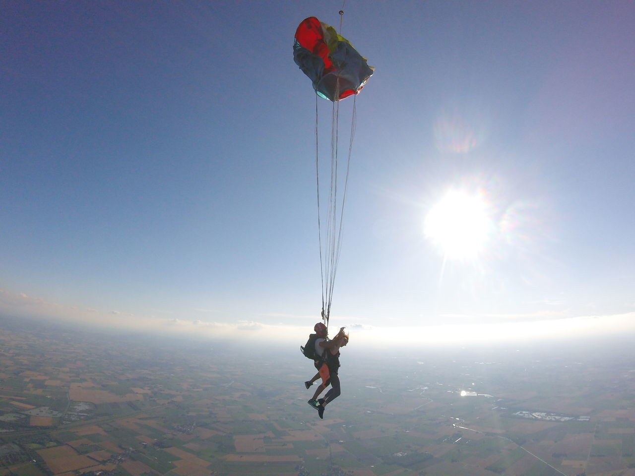 PERSON PARAGLIDING AT SUNSET