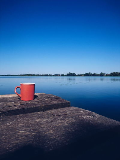 time to relax. Coffee Lake Lake View Landscape EyeEm Best Shots EyeEm Best Shots - Nature Spring Beauty In Nature Nature Minimalism EyeEm Best Edits Summer Cup Of Coffee Water Blue Drink Space Red Clear Sky Heat - Temperature Reflection The Still Life Photographer - 2018 EyeEm Awards