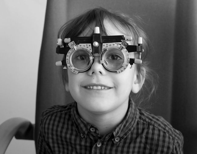 Portrait of a smiling kid with the ophthalmic glesses