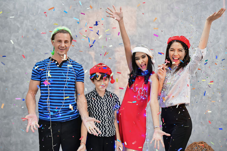 Arms Raised Body Part Celebration Confetti Emotion Enjoyment Front View Fun Group Of People Happiness Human Arm Human Body Part Human Limb Limb Looking At Camera Portrait Positive Emotion Smiling Standing Three Quarter Length Togetherness Women Young Adult Young Women